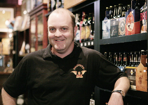 Jason Alvey, who owns the Four Firkins craft beer store in St. Louis Park, is a rarity among liquor store owners: He wants to see the ban on Sunday liquor sales lifted. (Staff photo: Peter Bartz-Gallagher)