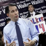 Walker buoyed by voter-ID, union-law victories