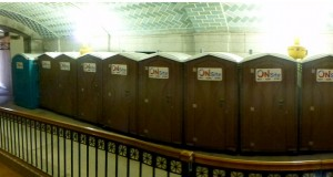 Ten self-contained, plastic portable toilets — with no heat, no water — are lined up in the horseshoe driveway below the Capitol's south steps. (Staff photo: Mike Mosedale)