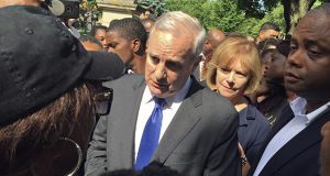 Minnesota Gov. Mark Dayton expresses his condolences to Diamond Reynolds for the death of her boyfriend, Philando Castile, outside the governor's residence Thursday in St. Paul. Castile was shot and killed by a police officer in Falcon Heights on Wednesday night. (AP Photo: Kyle Potter)