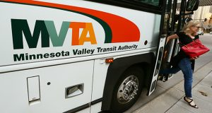 A passenger exits a Minnesota Valley Transit Authority bus in downtown Minneapolis. Suburban transit routes have a higher subsidy per passenger by several dollars than urban bus routes and light rail lines in the region, according to recently released Metropolitan Council data. (Staff photo: Bill Klotz)