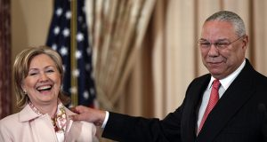 "In December 2009 then-Secretary of State Hillary Clinton welcomed former Secretary of State Colin Powell to the State Department in Washington for the unveiling of his official portrait. In a hacked email this year, Powell rapped Clinton for her ""unbridled ambition."" (AP file photo)"