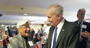 Gov. Mark Dayton speaks Wednesday with Janet Troutman-Simmons, a resident of Como by the Lake Apartments at 901 Como Blvd E. in St. Paul, after a press conference to unveil millions in affordable housing financing for projects around the state. (Staff photo: Bill Klotz)