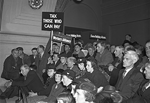 More than 1,000 left-wing protesters gathered at the Capitol on April 4, 1937, to support Gov. Elmer Benson as he tried to persuade the Legislature to pass a $17 million aid package for the unemployed. About 200 of the protesters stayed overnight in the Senate chamber after someone jimmied open the doors with a knife. (Submitted image: Minnesota Historical Society)