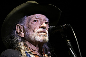 In this Jan. 7 photo, Willie Nelson performs in Nashville, Tenn. The 83-year-old outlaw country icon wants to help a lot of people give marijuana a try. (AP photo)