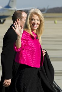 The president's counselor Kellyanne Conway waves to the media Jan. 26 at Andrews Air Force Base in Maryland. (AP photo: Jose Luis Magana)